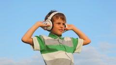 Portrait of happy boy in headphones dancing Stock Footage