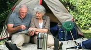 Seniors sitting near a tent Stock Footage