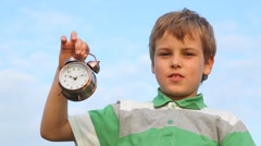 boy holding in his hand ringing alarm clock - stock footage