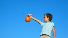 Boy launching ball with airscrew against sky Stock Footage