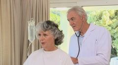 Doctor examining a patient Stock Footage