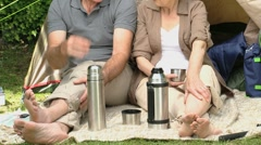 Seniors talking together in front of a tent - stock footage