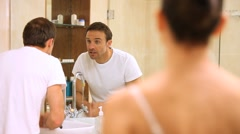 Couple getting ready in the bathroom Stock Footage