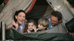 Family smilling at the camera in a tent Stock Footage