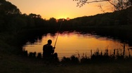Stock Video Footage of back view of fisherman stringing bait and casting the line into pond