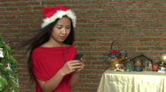 Asian Elf With Santa Hat Listens To Christmas Music - stock footage
