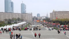 People walks to Poklonnaya Hill monument during Victory Day celebration Stock Footage