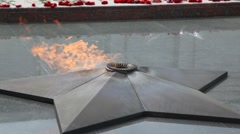 Stock Video Footage of close-up shot of eternal fire on Poklonnaya Hill monument, Moscow, Russia