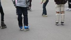 Legs of unidentified kids in roller skates on asphalt Stock Footage