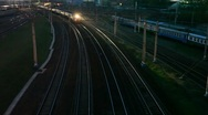 Stock Video Footage of suburban electric train moving on night railway near station