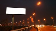 Stock Video Footage of empty billboard near bridge with moving cars