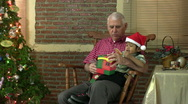 Stock Video Footage of Grandfather Opens Christmas Gifts With Grandson