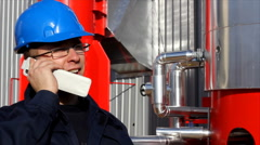 Worker talking on a mobile phone Stock Footage