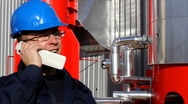 Stock Video Footage of Worker talking on a mobile phone