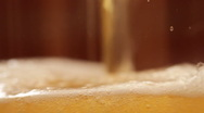 Beer is poured in a glass. Slow motion. Stock Footage