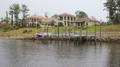 Spanish Style Waterfront Luxury Home on Inland Waterway Stock Footage