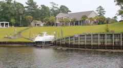 Waterfront Luxury Home on Inland Waterway with yacht Stock Footage
