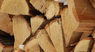 Cut and split firewood with snow falling Stock Footage
