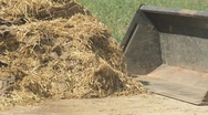 Stock Video Footage of Tractor turning manure pile 04