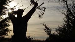 "Hunter ""BIG"" bow draw - silhouette - HD720p - stock footage"