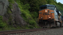 Freight train passing closeup Stock Footage