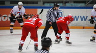 Stock Video Footage of Referee tosses puck on junior hockey match Spartak-Almaz of MHL in sports palace