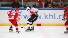 Tough fight for puck at side on junior hockey match Spartak-Almaz of MHL in Stock Footage