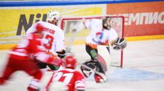Almaz goalkeeper catches puck on junior hockey match Spartak-Almaz of MHL Stock Footage