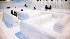 Children go labyrinth made completely from snow Stock Footage
