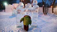 girl passes some times through gate in form of ice sculptures representing man - stock footage