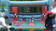 Children on Bouncing Castle - stock footage