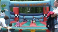 Children on Bouncing Castle Stock Footage