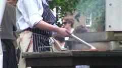 Turning Meat on a Barbecue Stock Footage