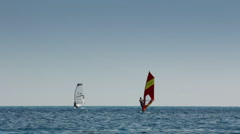 Windsurfing - surfers on blue sea surface Stock Footage