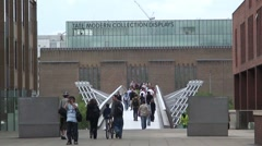 People Crossing the Millennium Bridge - stock footage