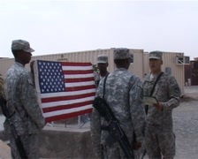 Reenlistment oath in Afghanistan under the American flag - stock footage