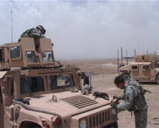 Taking machin gun out of Humvee Stock Footage