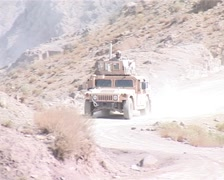 Stock Video Footage of Driving Humvee up the mountain patrolling