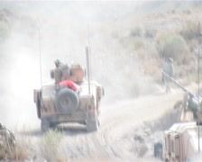 Humvee patrolling Afghanistan mountain Stock Footage