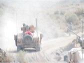 Humvee patrolling Afghanistan mountain Stock Footage