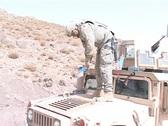 Soldier refreshing Humvee's engine Stock Footage