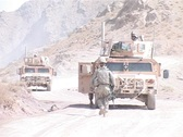 Stock Video Footage of Humvees on top of mountain patrolling Afghanistan