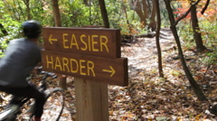 Easier or Harder trail. Biker goes by. Stock Footage