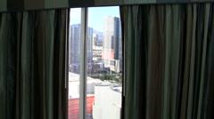Woman in bathrobe looks out window V4 - HD Stock Footage