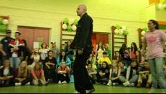 Bald-headed dancer in 2x2 breakdance battle Stock Footage