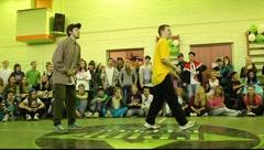 Boy in yellow t-shirt dancing in 2x2 brerakdance battle Stock Footage