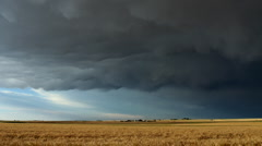 Storm Clouds over Wheat Field Timelapse Stock Footage