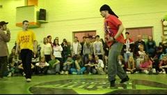 Boy in black bandana dancing in 2x2 breakdance battle Stock Footage