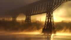 Dramatic misty fog dance around bridge Stock Footage