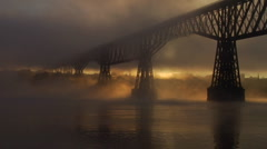 Railroad bridge shrouded in billowy fog Stock Footage